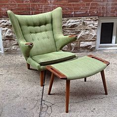 """Vintage Papa Bear Chair & Ottoman By Hans Wegner - Beautiful vintage true Danish modern Papa Bear chair designed by Hans Wegner with stamped Danish control tags on both ottoman and chair. This rare piece is hard to find in such excellent condition with the original matching ottoman. Upholstered in a clean subtle green, this piece is beautiful as is. This is the real deal!  Dimensions:  Chair-36"""" wide, 35""""deep, 38"""" tall Ottoman-27.5"""" x 16.5"""" x 16"""" tall - $SOLD"""