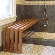 A beautiful teak shower bench can make transfers easy for wheelchair users or any abilities.