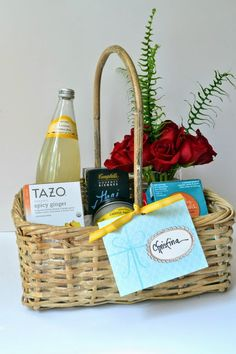 Get Well Gift Basket | Filled with different kinds of ready made soups, citrus scented candle, fresh flowers, snacks, nuts, bars, green tea and lemonade.