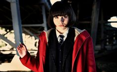 """Submarine (2010). Jordana Bevan is played by Yasmin Paige. """"Have you got the camera and the diary?"""" She's talking to Oliver Tate, played by Craig Roberts. Jordana takes Polaroid pictures as she kisses him under the railway bridge. Oliver in a voice-over: """"We kissed until our lips felt swollen. Her mouth tasted of milk, Polo mints, and Dunhill International."""""""