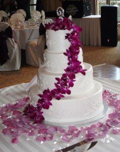 bright white cake with fuchsia orchids