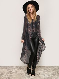 Look boho-chic in this free-flowing duster, featuring a sheer black construction with a button up front, V-neckline, and a rounded, high low hemline. Style with a black bralette, skinnies and top it off with a fedora. Unlined.