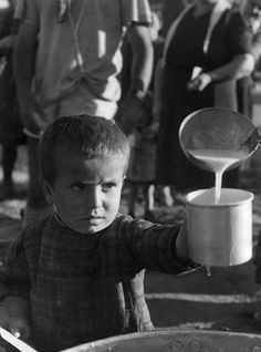 "Famine due to displacement and politicized food distribution worked their own violence. EAM organized national survival committees to feed people during the Axis occupation. The British also used food as leverage and blocked most aid. ""Orphan of the Greek War."" David Seymour. 1948."
