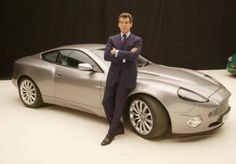 Actor Pierce Brosnan poses with an Aston Martin Vanquish at a press conference for the new James Bond film at Pinewood Studios Buckinghamshire. Aston Martin Vanquish, Aston Martin Volante, Aston Martin Vulcan, Aston Martin Lagonda, Aston Martin Cars, Aston Martin Vantage, Bmw Z8, James Bond Cars, James Bond Movies