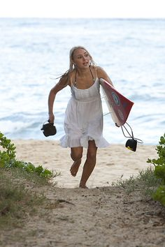 Soul Surfer! I love this scene. In two minuets she goes from surfing right to church!