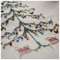 "Love this idea of simple cross stitch tree ""decorated"" with ""ornaments"" = bead & charms treasures from your stash. Pattern is in the book ""Stitch"" by Penny Black Ribbon Embroidery, Cross Stitch Embroidery, Embroidery Patterns, Cross Stitch Patterns, Cross Stitch Tree, Simple Cross Stitch, Christmas Embroidery, Christmas Cross, Winter Christmas"
