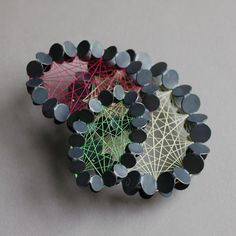 Misun Won; Three layered silk brooch, silver and silk thread