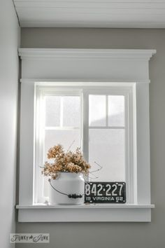 Funky Junk Interiors craftsman style window trim using flat lumber and not moulding via Remodelaholic