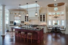 Wonderful kitchen with banquet seating. Note ceiling treatment above dining area. Traditional Kitchen by Drury Design Kitchen & Bath Studio