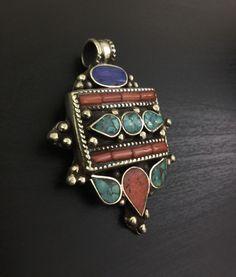 Tibetan brass pendant.  Inlaid with turquoise stone and coral shavings. Artisan made. Tibetan necklace. Ethnic pendant.  Tribal jewelry.  #tribal #bohostyle #gypsy #jewellery #ethnic #necklaces #necklace #boho #tibetan #nepalese #pendant # pendants #jewelry #tibetanjewellery #gift #birthday #handmade #style #bohemian #styleblogger #fashion #trend