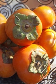 Persimmons!!! i love these.  my grandma and grandpa have one at their house.  when my grandpa died the Persimmon tree died as well.  now i have to buy them from the store.... just not the same...