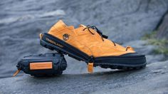 The Radler Trail Camp Folding Shoes by Timberland are hiking shoes with a twist. Super lightweight...water repellant, just hook on to your backpack.
