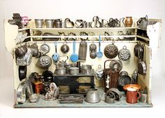 German doll kitchen, ca. 1900. width : 1.11 m x depth : 52 cm x height  Furnished with stove, attached shelves, and many kitchen wares of wood, sheet metal, copper, porcelain and ceramic.