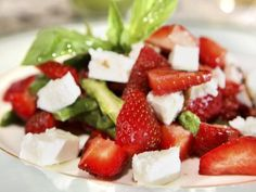 20 Low-Calorie Salads That Won't Leave You Hungry: Summer Greens with Strawberries and Feta http://www.prevention.com/food/cook/20-low-calorie-salads-wont-leave-you-hungry?s=11&cm_mmc=Recipe-of-the-Day-_-1693938-_-05132014-_-buffalo-fiesta-salad-Image
