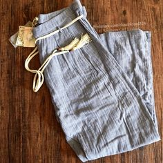 FREE PEOPLE Pants Striped Tassel Tie Gauze Trouser Size Euro 42, US 10 (Medium).  New With Tags. $248 Retail + Tax.   Handmade pleated gauzy striped pants with braided tassel belt. 4 pockets & zip fly button closure. By Mes Demoiselles Paris for Free People.   Cotton. Imported.     ❗️ Please - no trades, PP, holds, or Modeling.    Bundle 2+ items for a 20% discount!    Stop by my closet for even more items from this brand!  ✔️ Items are priced to sell, however reasonable offers will be…