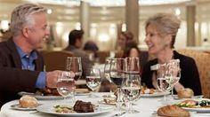 Couple enjoying an exquisite dinner onboard an Oceania Cruise - Avoya Travel Article: 'Luxury Cruise Week Spotlight: Oceania Cruises'
