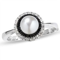 This would be the perfect anniversary present - pearl for June (or wedding month) and black & white diamonds.