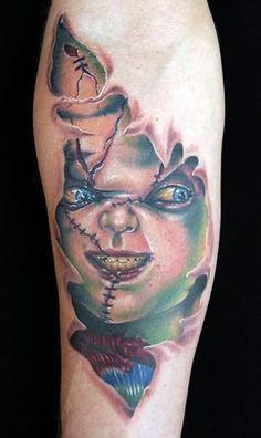 Chucky Skin Tattoo On Arm