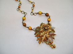 """""""Autumn Breeze"""" by Novegatti Designs.  Polymer clay leaves with B'Sue leaves, flowers, and spectra beads.  www.facebook.com/NovegattiDesigns"""