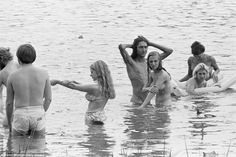 A group of people swim naked in the lake at the Woodstock Music & Art Fair, Bethel, NY, August Get premium, high resolution news photos at Getty Images Woodstock Music, Woodstock Festival, Woodstock Concert, 1969 Woodstock, Woodstock Pictures, Old Photos, Vintage Photos, Lise Sarfati, Rare Historical Photos