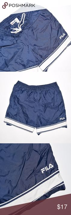 Vintage 90's FILA Nylon Athletic Running Shorts Brand: FILA  Item name: Vintage 90's Men's Nylon Running Shorts  Color: Blue  Condition: This is a pre-owned item. Aside from some fraying on the drawstring and a small stain on the bottom of the front and back of the shorts (see photo) they are in great condition with no rips, holes, etc. Comes from a smoke free household.  Size: Large  Measurements:   Waist - 16 inches (elastic drawstring waistband)  Length - 19 inches  Rise - 13 inches…