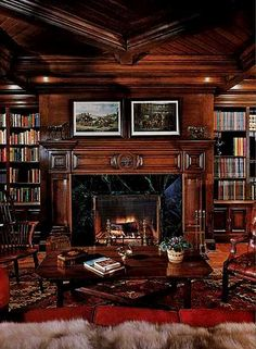 Classic dark paneled library....would just add cozy club chairs and throw blankets