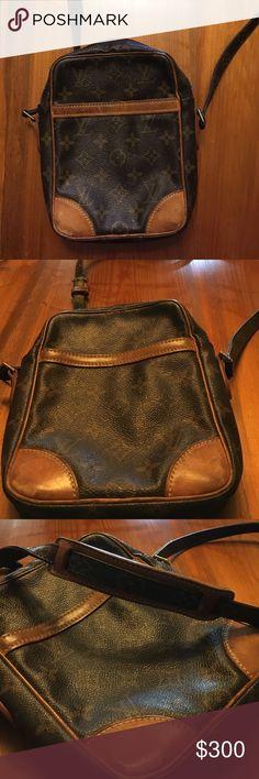 Louis Vuitton Danube. Louis Vuitton Danube.  Sticky outer pocket.  Inside not sticky.   Favorite cross body Louis Vuitton Bags Crossbody Bags