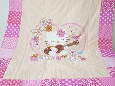 Hello Kitty quilt blanket , baby girl pink quilt , personalized quilt  https://www.etsy.com/listing/203504321/hello-kitty-quilt-blanket-baby-girl-pink?ref=related-1