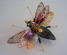 "Artist Julie Alice Chappell has created Computer Component Bugs, a gorgeous line of delicately graceful insect sculptures crafted from recycled computer circuit boards and other ""printed ephemera."" 