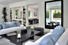 Clean, simple and modern living room in black, white and blue. Discovered on www.Porch.com - Organize in #Klaserapp