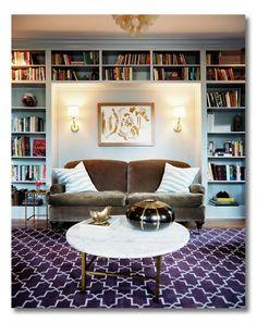 sofa, perfectly set back into a nook between bookshelves
