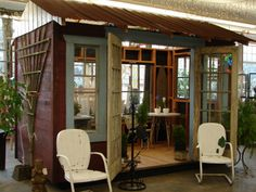 Charming outdoor building or shed made from old doors, windows and architectural salvaged materials