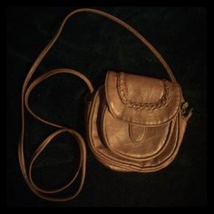 "Small Brown Crossbody Pre-owned but still in very good condition! Small crossbody perfect addition for a night out! Has a zipper pocket and front pocket when magnetic close is opened as shown in pictures! Zipper is a little harder to work because I've had this purse for roughly 5 years. For reference, I am 5'2"". Tilly's Bags Crossbody Bags"