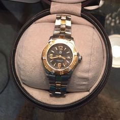 $1.99 SHIPAuth Tag Heuer Watch with Case & Box Authentic Professional Ladies' Tag Heuer Quartz Sports Watch. Two-toned stainless steel and gold face and band. Comes in original case and hard outer box with Certificate of Authenticity and Instruction Manual. BRAND NEW BATTERY! Tag Heuer Accessories Watches