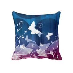 Butterfly Silhouettes on Blue and Purple Throw Pillow      Produced by sustainably employed single moms in the USA