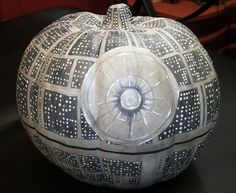 "Death Pumpkin - This artificial pumpkin is approx 7.5″ tall, and a diameter of 9″. Has been painted to resemble the Death Star from the famous Star Wars films. The ""windows"" and the Superlaser Focus Lens have all been painted with a special paint that is UV (""Black Light"") reactive which also glows in the dark! design is 360 degrees, including ""stem"" & bottom."