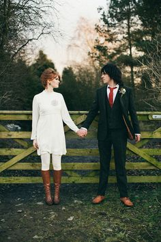 60s style mini wedding dress worn with white tights and tan knee high boots