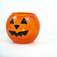 This jack-o'-lantern candle holder is super cute, super easy and a great Halloween craft for the kiddos!