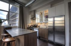 too modern.but LOVE the door Toronto Lofts, Concrete Column, Lofts For Rent, Linen Cupboard, Multi Family Homes, Display Homes, Home Trends, Guest Suite, Workout Rooms