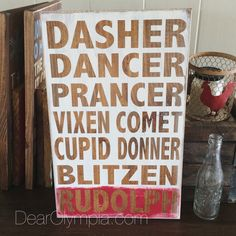 Reindeer and Rudolph Hand painted subway art sign using CeCe Caldwells Paints on solid pine. Colors used: Jersey Tomato and Simply White with Hickory stained wood background. Love this rustic Christmas sign! #dearolympia #cececaldwellspaints #christmas #christmasdecor #rudolph #reindeer