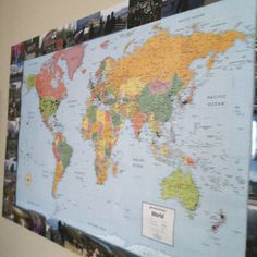 World map surrounded by pictures of places I've been. I mounted the map on cork board so could put pins in the places I've been. Great wall piece and easy to do!