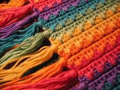 Very colorful *Inspiration* - could be a scarf, afghan, etc. #1 reason that I like this is because you can incorporate your ends into the fringe. Weaving in the ends is the #1 reason I normally pass any multi-color pattern up.