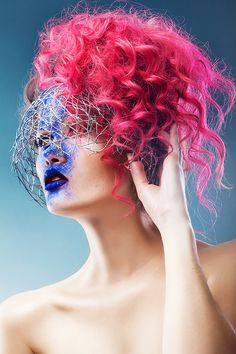 woman with wire web and pink hair