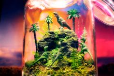 Jurassic Dinosaur World  Terrarium / Diorama by Megatone230. I am not a fan of fake plants but I just love these! Hmm... Maybe switch fake for real plants?