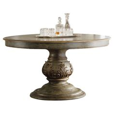Stylist's Tip: This stunning dining table offers an heirloom-worthy look that you'll treasure for a lifetime. Its detailed pedestal base offers a touch of op...