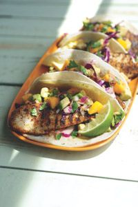 Fish tacos with mango salsa.  Add a birds eye chili to the salsa and its a winner!