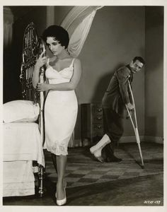 Elizabeth Taylor and Paul Newman for Cat on a Hot Tin Roof directed by Richard Brooks, 1958. Photo by Virgil Apger