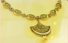 Gold Wedding Jewellery collection by Nikhaar Jewellers is crafted especially for south indian bride and have heavy necklaces which are perfect for layering. Gemstone Necklace, Gold Necklace, Gold Wedding Jewelry, South Indian Bride, Jewelry Patterns, Necklace Designs, Jewelry Collection, Jewels, Gemstones