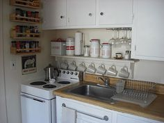 RV kitchen storage...make a shelf that goes across the back of the counter...
