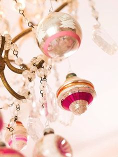 Pink Christmas~ Vintage ornaments and bead garland on a chandalier. very pretty.